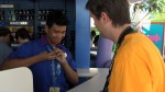 Adam trades a pin at the EPCOT pin station